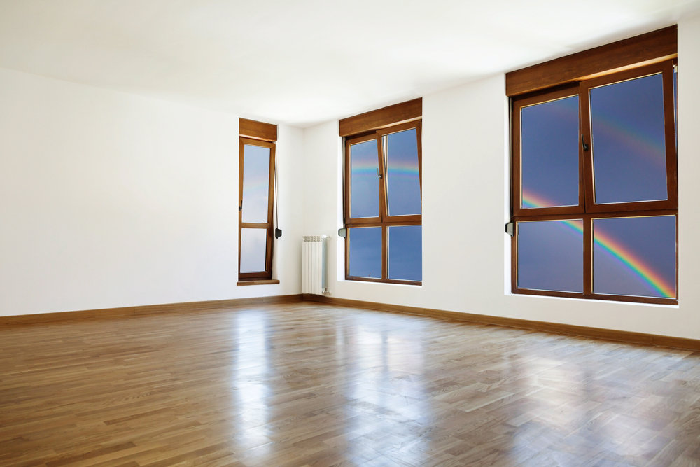 Empty interior room and three windows